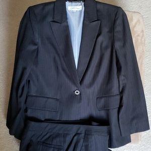 Calvin Klein black pinstriped suit